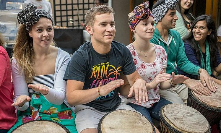 Cameron Cross drumming at an iXperience cultural immersion day in Cape Town